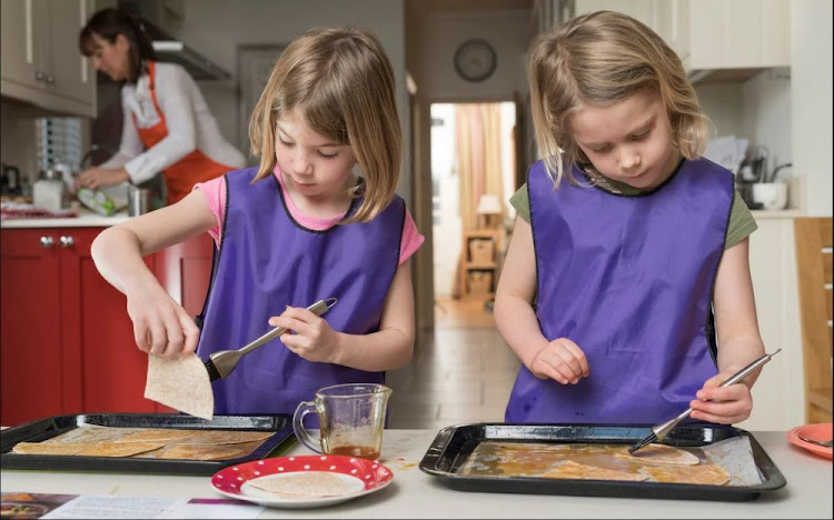 With a bit of help, little ones as young as two can help prepare meals, say two TV experts