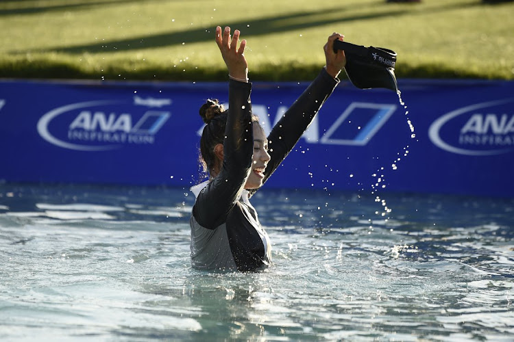 Patty Tavatanakit celebrates in Poppie's Pond after winning the ANA Inspiration golf tournament at Rancho Mirage Country Club on April 4, 2021 in Rancho Mirage, California