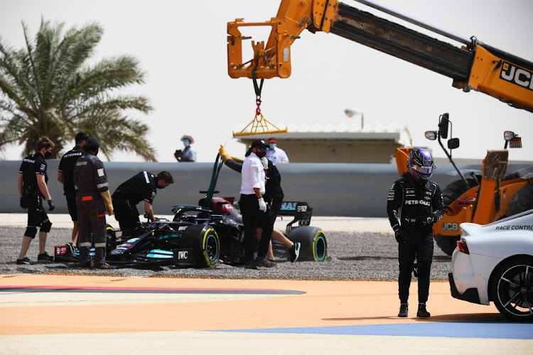 Lewis Hamilton of Great Britain and Mercedes GP makes his way to the race control car after stopping on track during day two of testing at Bahrain International Circuit on March 13 2021.