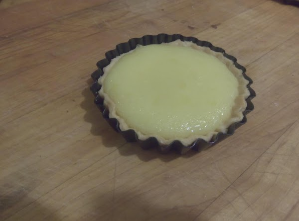 Pour the curd into the tart pans and place in a 300 degree oven...