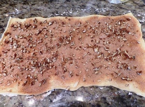 Spread chopped pecans on cinnamon/sugar covered sheet.