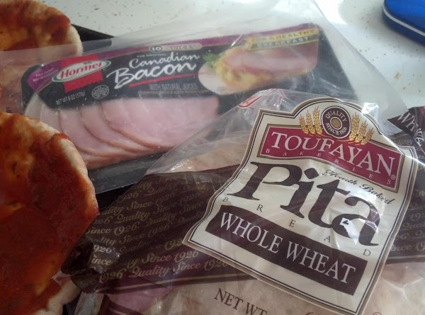Use both layers of pita pocket.  Don't separate.  Place on cookie sheet...
