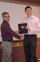 Photo: Nikita Kitaev accepting the Mark D. Weiser Excellence in Computing Scholarship.