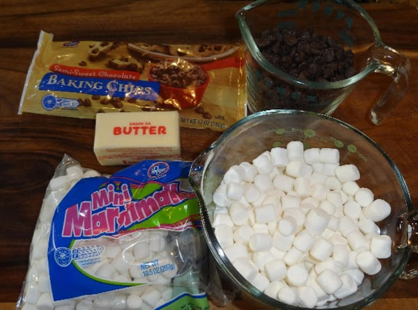 Assemble all the ingredients before you begin. (chocolate chips, butter, marshmallows and chopped walnuts.)