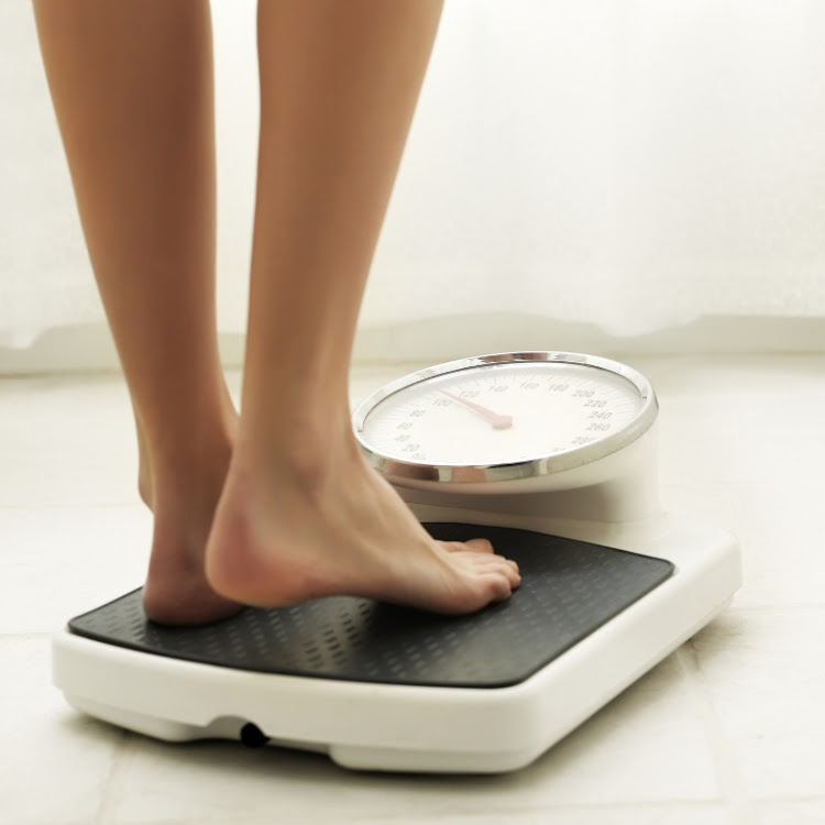 Regularly weighing yourself at home is one way to avoid weight gain over the holiday period according to new research.