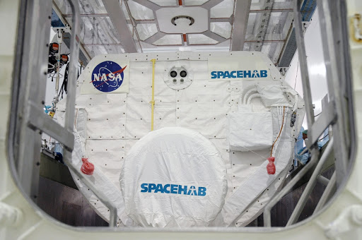 In the Space Station Processing Facility the Spacehab module is settled into place in the payload canister.