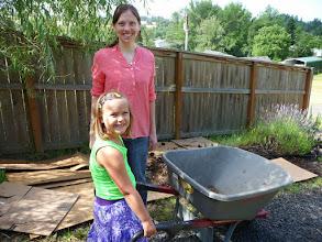 Photo: Emily helps Karuna with the wheelbarrow