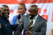 Pitso Mosimane and Steve Komphela during the Absa Premiership match between Kaizer Chiefs and Mamelodi Sundowns at FNB Stadium on January 09, 2016 in Johannesburg, South Africa.