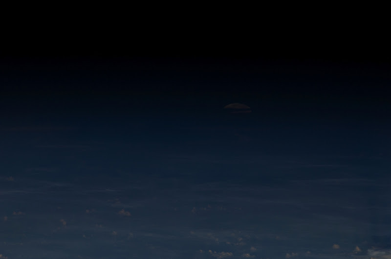 Photo: Full moon over Earth photographed from the International Space Station 19:18:48 May 5, 2012. Credit: NASA