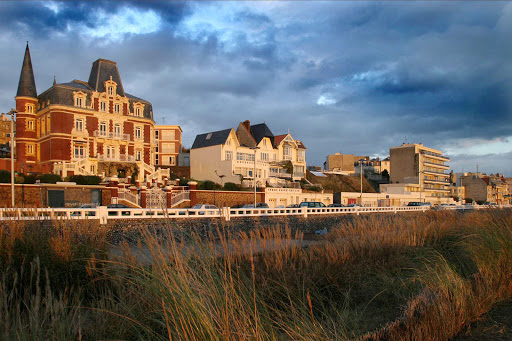 Buildings along the promenade of Le Havre, France, at dusk.