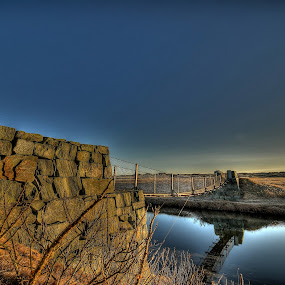Bridge over still water by Frøydis Folgerø - Landscapes Waterscapes ( sky, brick, pwcreflections, stone, bridge, early spring )
