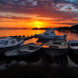 Sunset over safe port by Branko Meic-Sidic - Transportation Boats ( orange, seascape, pirovac, port, sunset, dramatic, porat, boats, prosika, sea )