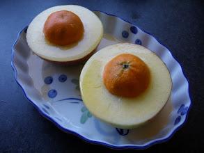 Photo: Mandarin capped apples before roasting