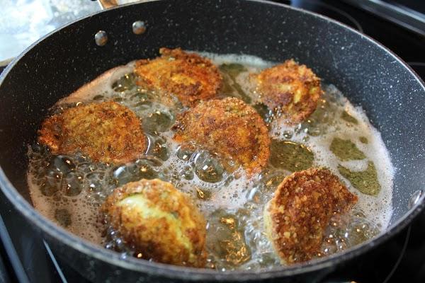 Frying ravioli in a pan.