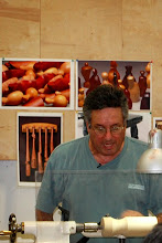 Photo: Mark starts turning basic shapes on a cylinder showing proper spindle turning technique.