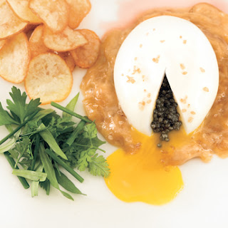 Soft-Cooked Eggs with Onion Soubise, Caviar, and Potato Chips.