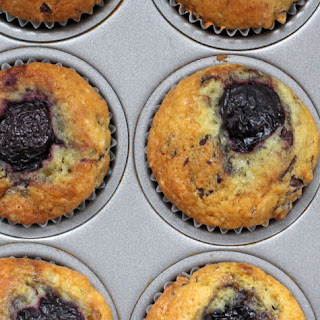 Sour Cream Muffins with Chocolate Chunks and a Cherry