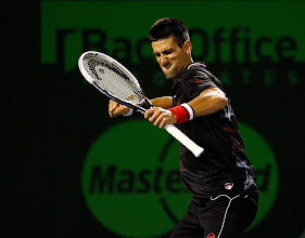 Photo: KEY BISCAYNE, FL - MARCH 24:  Novak Djokovic of Serbia reacts to winning a point against Marcos Baghdatis of Cypress during Day 6 of the Sony Ericsson Open at Crandon Park Tennis Center on March 24, 2012 in Key Biscayne, Florida.  (Photo by Mike Ehrmann/Getty Images)