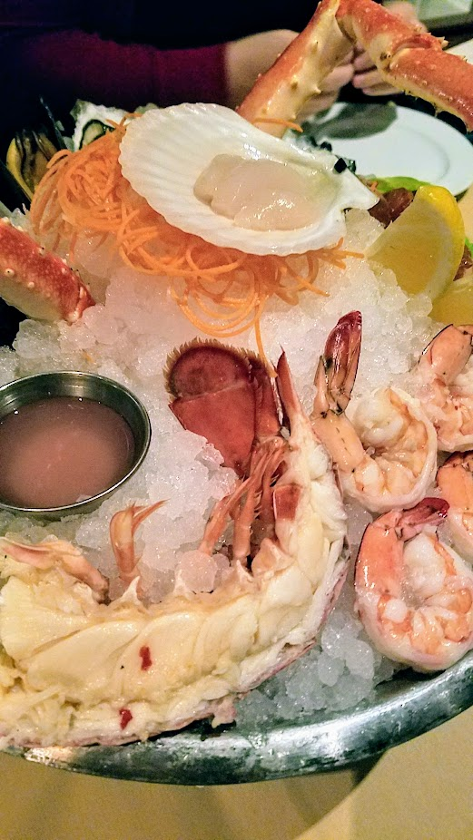 A Nice Dinner at Ringside Fish House with a Fresh Seafood Platter arranged with King Crab Legs, Hokkaido Scallop, Gulf Prawns, Oysters, Mussels, Manila Clams, House Smoked Salmon