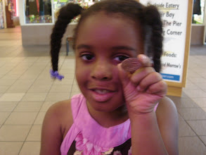 Photo: Kaleya holds up her pressed penny