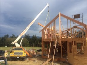Photo: Four shots of the roof beam going in!