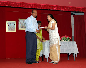 Photo: Mrs. Aarthi receiving a token of appreciation for TAPAS Reading Program