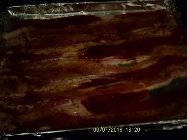 On an aluminum foil cover baking sheet place bacon.  Drizzle honey over the...