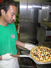 Photo: This is a white pizza  with Kalomoto olives and grape tomatoes. This photo is from 2010 season.