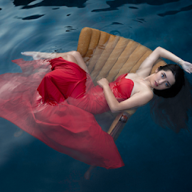 And So She Floated by Shawnessy Ransom - People Portraits of Women ( dark waters, blue water, fine art portraits, lady in red, red dress, water )