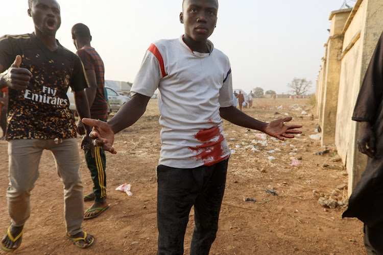 A man reacts as a riot broke out after the arrival of the rescued JSS Jangebe schoolgirls in Jangebe, Zamfara, Nigeria March 3 2021.
