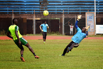 Photo: Alhassan 'Crespo' Kamara takes on goalkeeper John Trye  [Leone Stars Training Camp, in advance of Equatorial Guinea game, Sept 2013 (Pic: Darren McKinstry)]