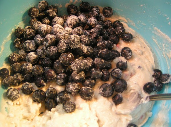 Lightly dust berries with a light coating of flour and gently fold in batter,...