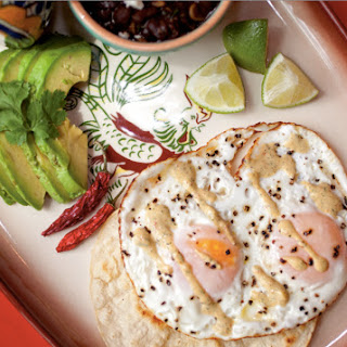 Fried Egg Taco With Avocado And Chipotle Black Beans.