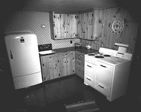 Photo: The knotty pine cabinets remind me of Ozzie and Harriet. For those who recall the show, the set was created to duplicate as much as possible the Nelson's actual home. The show was shot in the 50's, but their kitchen  may have been done in the 40's with similar cabinets
