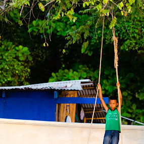 Swinging  by Bryce Anderson - Babies & Children Children Candids ( panga, child, jungle, costa rica, beach, swing, young, kid )