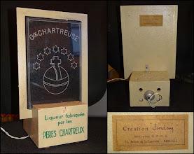 """Photo: Une Publicité sur le Lieu de Vente à l'ancienne ! Liqueur fabriquée par les Pères Chartreux.  Cette création """"Jendem"""" se branche sur le courant mais pour produire quel effet ?  """"Breveté S.G.D.G. - 75, avenue de la Capelette - Marseille"""""""