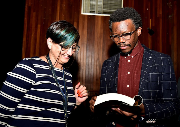 Adv Tembeka Ngcukaitobi's book The Land is Ours was launched in Port Elizabeth last night.Lindi Coetzee was lucky to get her copy of the book autographed by the author.