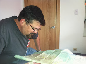"""Photo: Brian spent a lot of time staring at maps... """"seeking the road less traveled"""". Oh boy, did we find them!"""