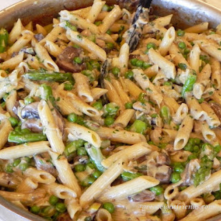 Penne Pasta with Pancetta, Mushrooms, Caramelized Leeks, Peas and Asparagus in Sage Cream Sauce.