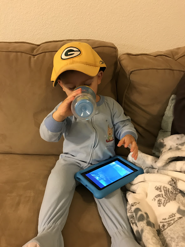And now Logan sporting Gramps' Packer hat after their first playoff win...and enjoying a cold one.
