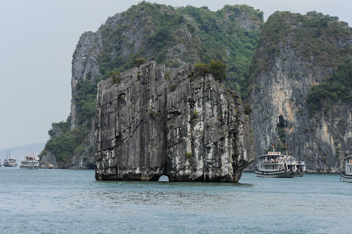 Ponant-Vietnam-Ha-Long-Bay.jpg - See the mesmerizing limestone rock outcroppings in Ha Long Bay during a Ponant cruise of Vietnam.