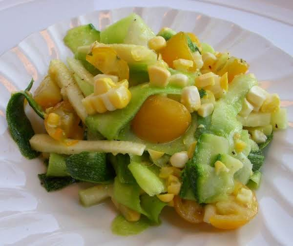 Ribbons Of Zucchini With Beautiful Yellow Dots Of Fresh Corn And Yellow Cherub Tomatoes