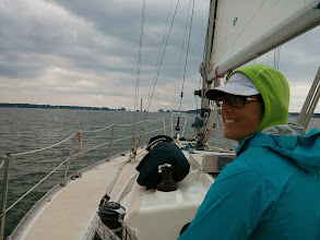 Photo: Anne at the helm as we enter Put-In-Bay, OH