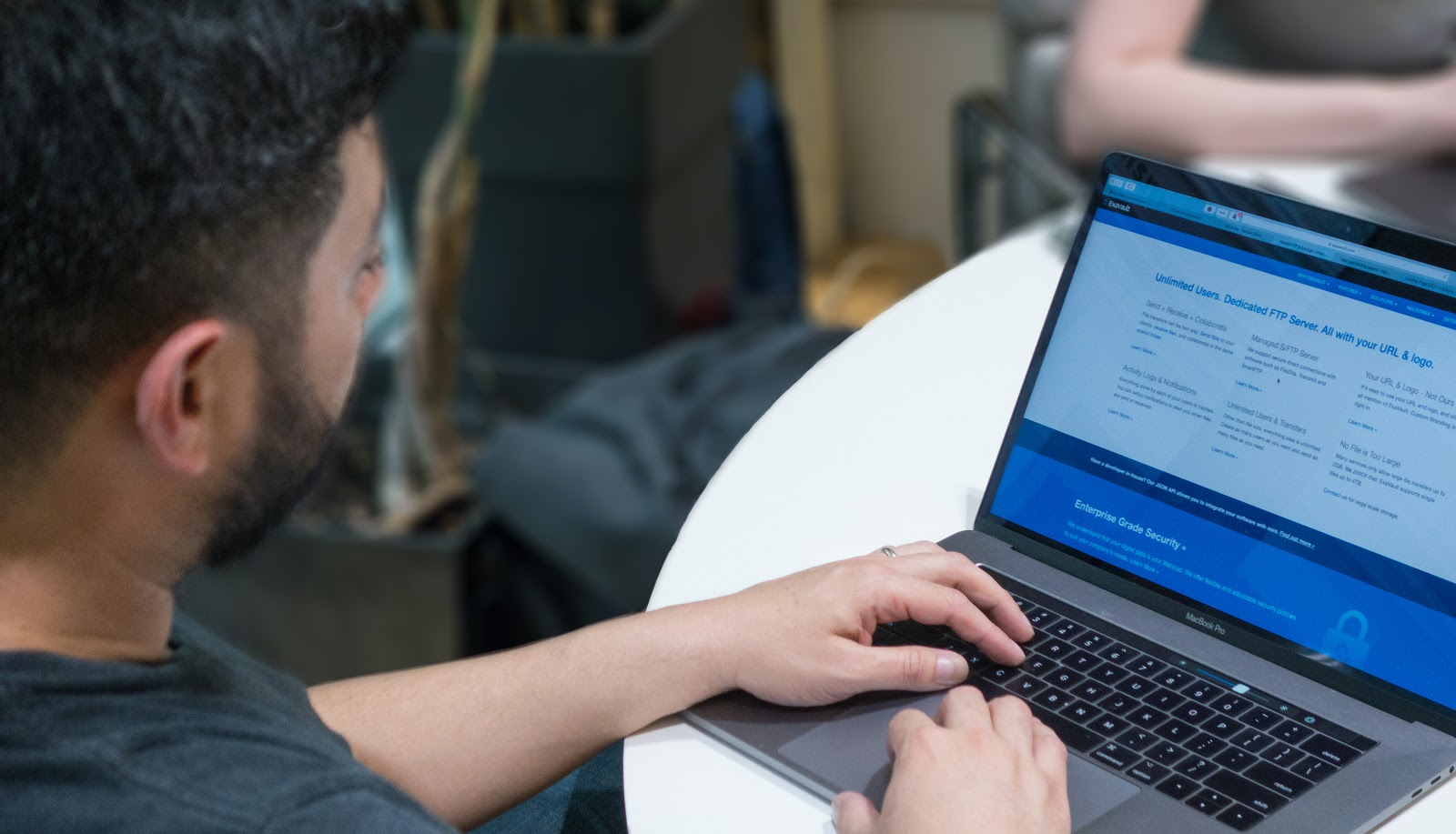 Person reviewing ExaVault features on their laptop.