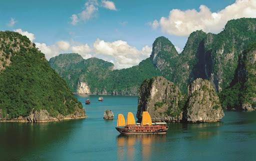 Hạ Long Bay, in northeast Vietnam, is known for its emerald waters and countless towering limestone islands topped by rainforests.