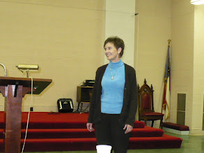Photo: Debbie Menard leading us singing Christmas carols