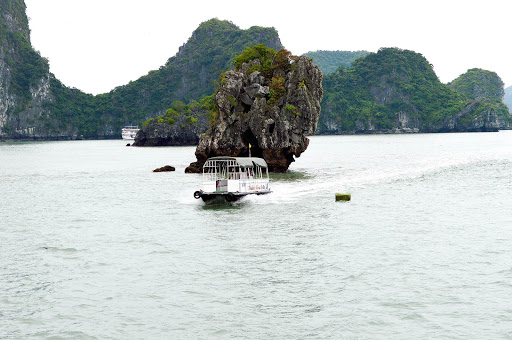 ferry-in-ha-long-bay.jpg - A ferry glides past stunning rock outcroppings in Ha Long Bay.