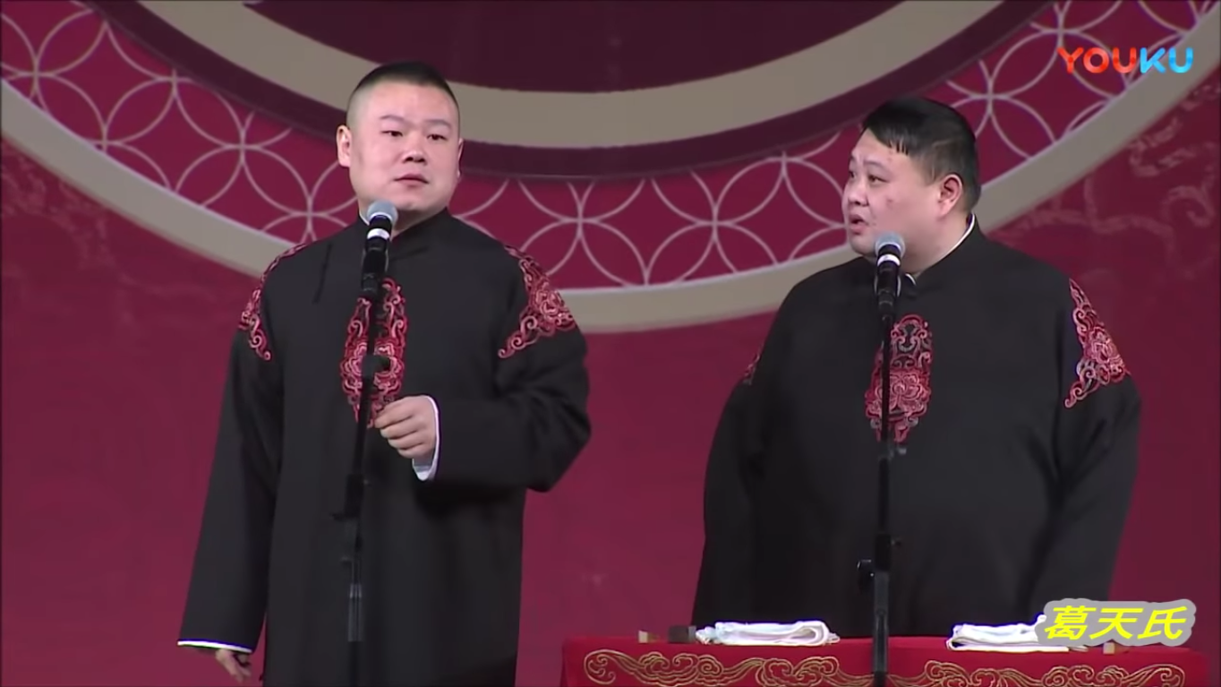two male comedians in traditional cheongsam performing a stand-up skit at the spring festival gala