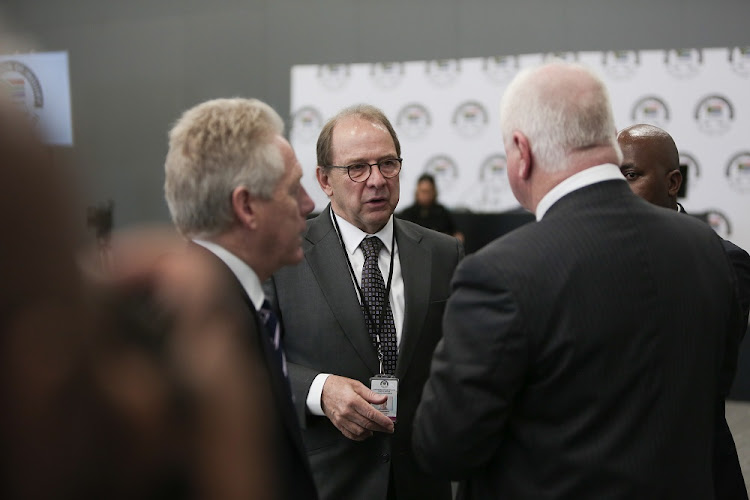Head of the legal team Advocate Paul Pretorius (Centre) talks to other lawyers during a tea break, 20 August 2018, in Parktown, Johannesburg, during the opening day of the the State Capture Inquiry.