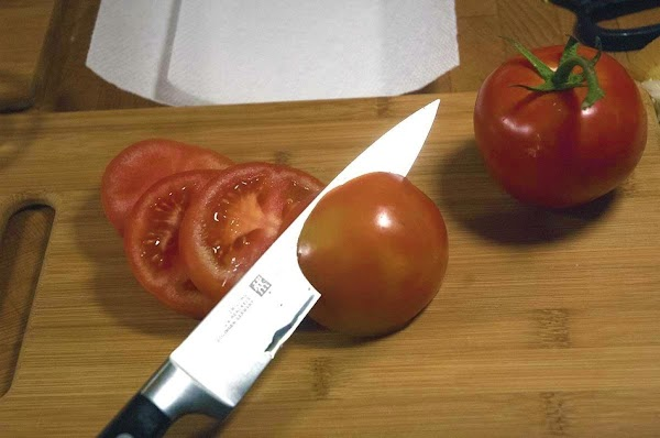 Slice the tomatoes into 1/4-inch (.6cm) slices.